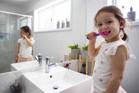 Brisbane youngster Emily Williams 3, saves water by brushing her teeth with the tap off..jpg