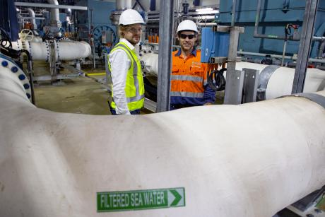 Gold Coast Desalination Plant Maintenance Planner Brian Woods and Project Engineer Daryl Harding pictured in the facility's pump room