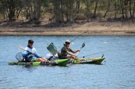 Two people Paddling in canoes at Kurwongbah