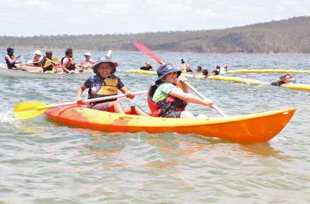 Children enjoy canoeing on Lake Wivenhoe at Billies Bay for Play it safe day in 2016
