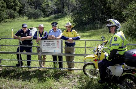 Representatives from Queensland Police and Seqwater at the site of the newly installed fence at Mt Crosby